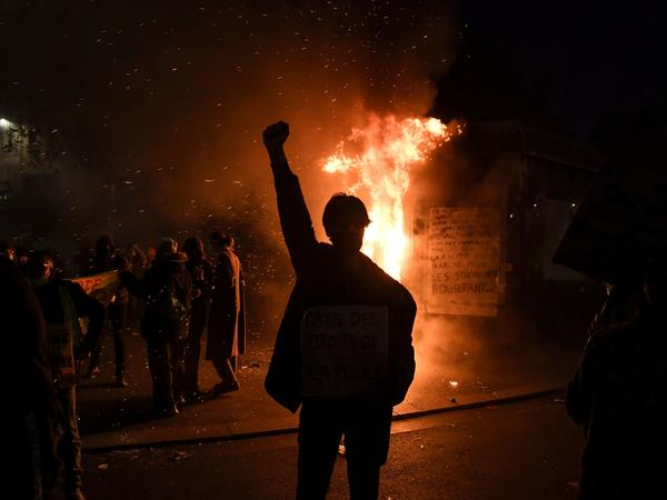Thousands of protesters across France hit the streets Saturday to condemn police brutality and a proposed law that would make it harder to publicize images of on-duty police officers.