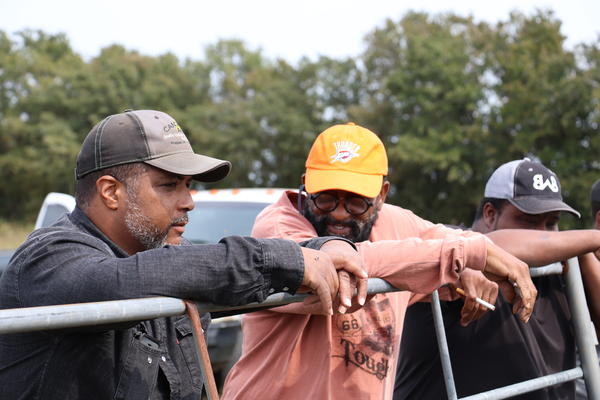 Nathan Bradford Jr. (left), a rancher speaks with Willard Tillman (right), the executive director of the Oklahoma Black Historical Research Project. Tillman is helping Bradford install a solar water well system on his land near near Bristow, Oklahoma.