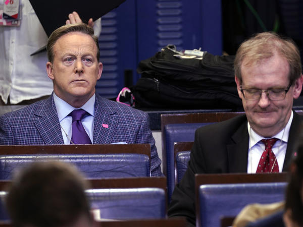 Sean Spicer (left), the former White House press secretary and an on-air personality for Newsmax, listens during a March coronavirus task force briefing at the White House.