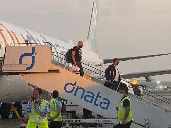 Israeli tourists deplane from a FlyDubai flight from Tel Aviv to Dubai, on Nov. 28.