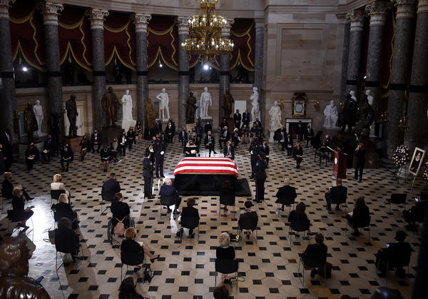Members of Congress and guests pay their respects to the late Associate Justice Ruth Bader Ginsburg as her casket lies in state during a memorial service in her honor in Statuary Hall of the U.S. Capitol.