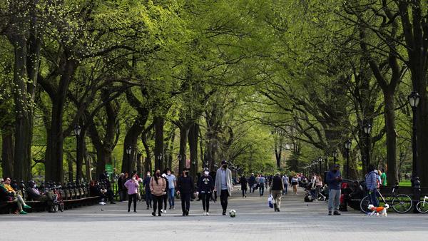 Masked pedestrians enjoy Central Park earlier this year. The New York destination now has a site-specific soundtrack courtesy of composer Ellen Reid's Soundwalk app.