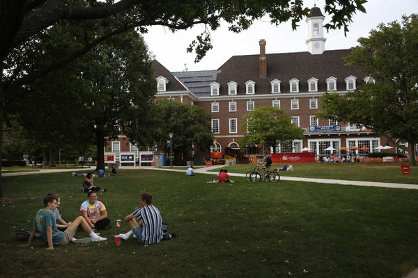 Students chat on a lawn this fall at the University of Illinois at Urbana-Champaign. It's unclear how disruptions to campus life during the pandemic might affect student voter turnout on Election Day.