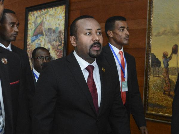 "Ethiopia's Prime Minister Abiy Ahmed, center, arrives for the opening session of the 33rd African Union Summit in Addis Ababa, Ethiopia, in February. On Wednesday, Abiy ordered the military to confront the Tigray regional government after he said it attacked a military base overnight, citing months of ""provocation and incitement"" and declaring that ""the last red line has been crossed."""