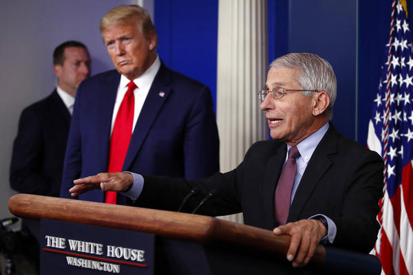 In this April 22, 2020, file photo, President Donald Trump listens as Dr. Anthony Fauci, director of the National Institute of Allergy and Infectious Diseases, speaks about the coronavirus in the James Brady Press Briefing Room of the White House.