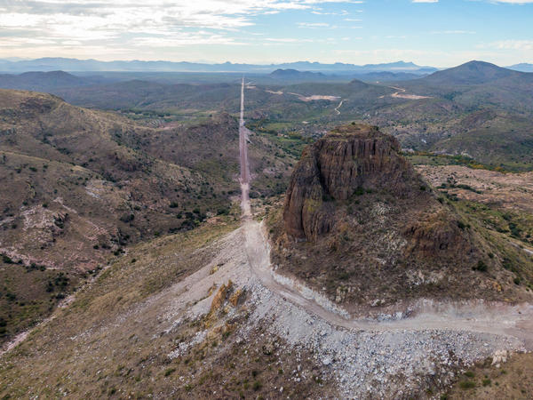 In the Guadalupe Canyon in southeastern Arizona, work crews are dynamiting mountainsides and bulldozing access roads in this stunning landscape to make way for the border wall. Mexico is on the left.