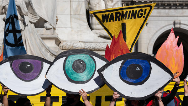 Climate activists protest in Washington, D.C., the day after the election. Some progressives want President-elect Joe Biden to bar any appointees with fossil fuel ties.