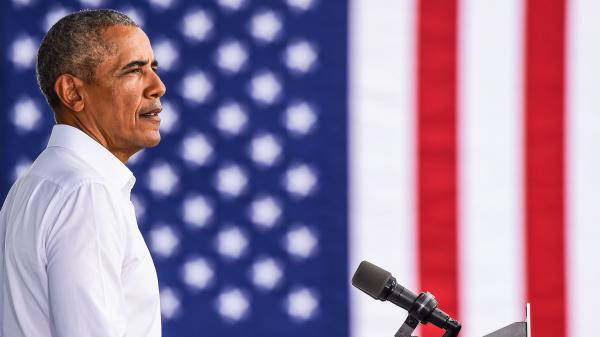 Former President Barack Obama speaks at a Biden-Harris drive-in rally in Miami on Oct. 24. In his first interview with Terry Gross, Obama talks about what he misses most about being president and reflects on the turmoil of the Trump White House. Obama's new memoir is <em>A Promised Land.</em>