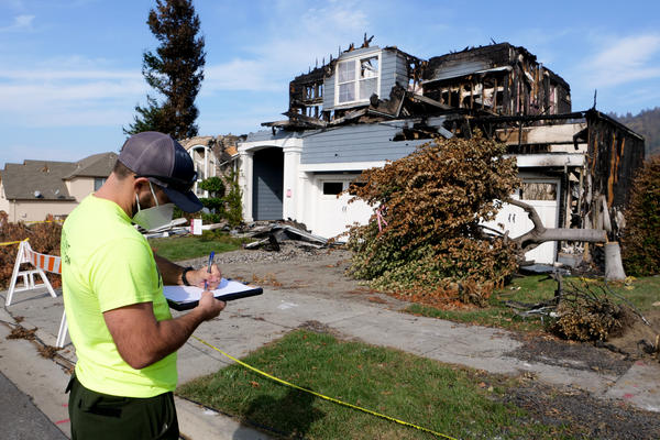 Daniel Gorham, a research engineer with the Insurance Institute for Building and Home Safety, looks for clues about how homes can survive wildfires.