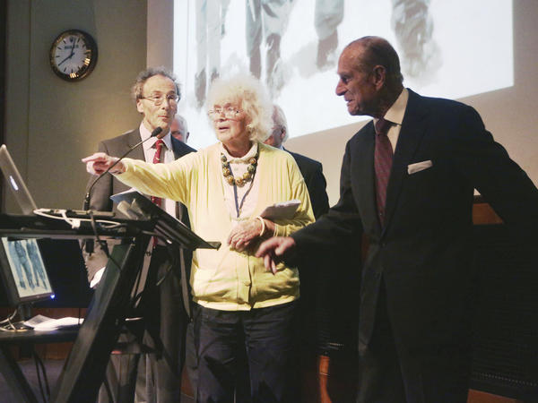 In this May 29, 2013 file photo, travel writer, journalist and author, Jan Morris, center, with the Duke of Edinburgh, right, during a reception to celebrate the 60th Anniversary of the ascent of Everest, at the Royal Geographical Society in London.