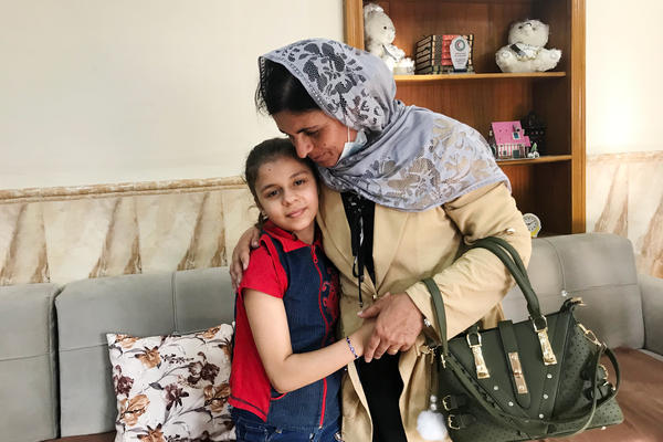 Kamo Zandinan says goodbye in the Mosul orphanage to a 10-year-old girl she believes is her daughter Sonya, taken from her by ISIS six years ago. The girl was rescued by police in March from an Arab family to whom she was not related. Zandinan is waiting for DNA tests to confirm whether the girl is her daughter.