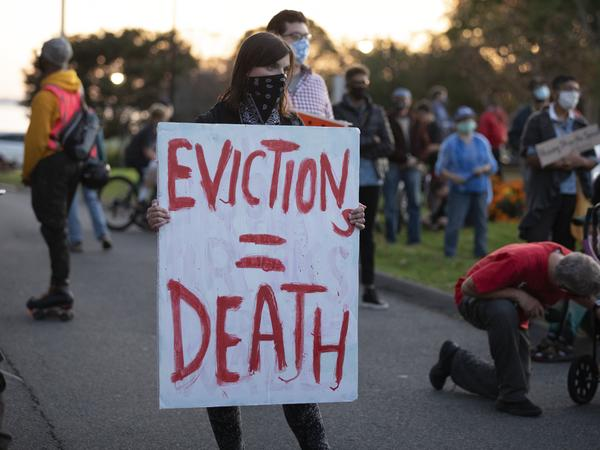 Housing activists gather in Swampscott, Mass., in October to call on the state's governor to support more robust protections against evictions and foreclosures during the pandemic.
