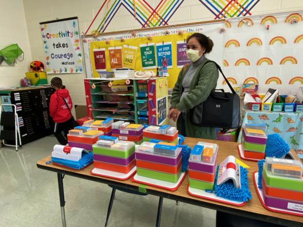 Milagros Macher asks about individual Osmo art and reading kits on a tour of Our Lady of the Assumption School.