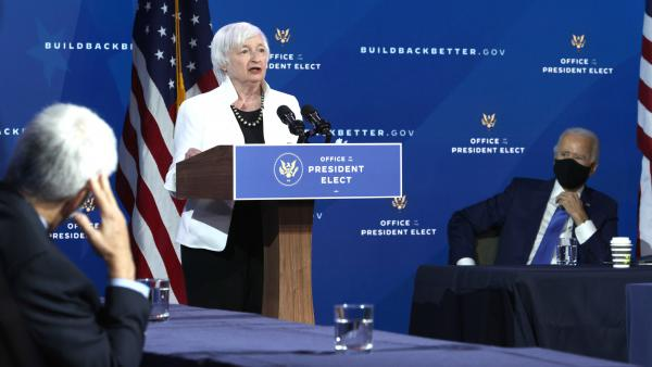 Janet Yellen, President-elect Joe Biden's nominee for treasury secretary, gives remarks Tuesday in Wilmington, Del., as Biden and other members of his economic team look on. If confirmed, Yellen would be the first female treasury secretary.
