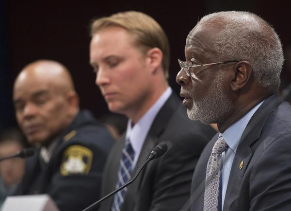 Police Chief John Dixon (L), of Petersburg, Virginia, Chris Kitaeff (C), board member of Arizonans for Gun Safety and a gun dealer, and former US Surgeon General David Satcher (R), speak during a forum on gun safety reform on Capitol Hill in Washington, DC, December 8, 2015. (SAUL LOEB/AFP via Getty Images)