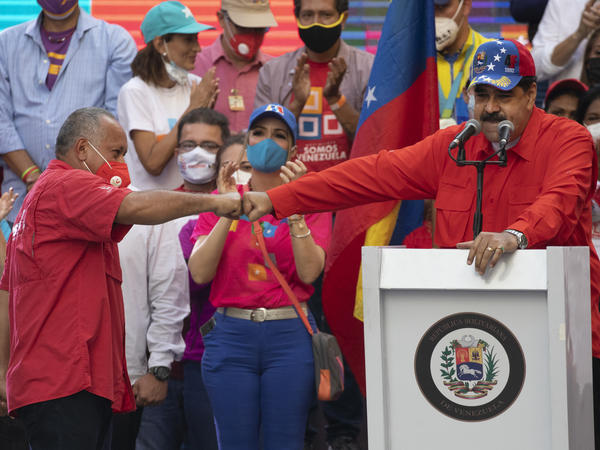 Diosdado Cabello (left), a candidate in Venezuela's upcoming National Assembly elections, bumps fists with Venezuelan President Nicolás Maduro during a closing campaign rally in Caracas, Venezuela, on Thursday. Venezuelans will vote for a new National Assembly on Sunday.
