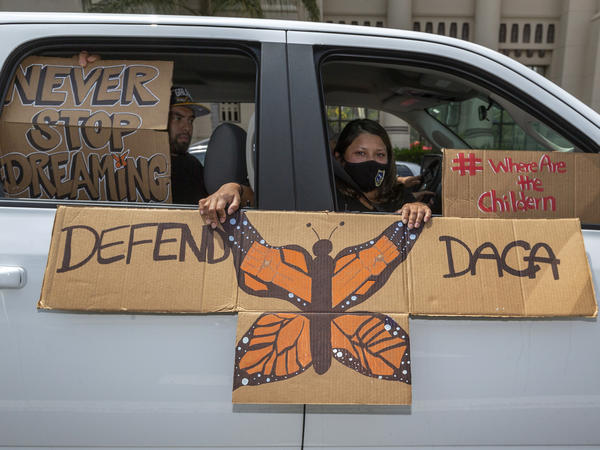 """People demonstrate in June in Los Angeles in favor of the Deferred Action for Childhood Arrivals program. Immigrant rights advocates hailed a Friday court ruling allowing new applications as a """"huge victory for people who have been waiting to apply for DACA for the first time."""""""