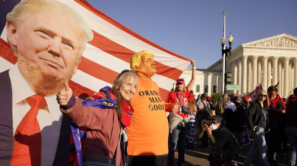 Supporters of President Trump attend pro-Trump marches outside the Supreme Court in Washington on Nov. 14. The Trump team was dealt several losses in multiple courts Friday.
