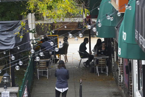Customers sit outside a restaurant offering outdoor service in New York in October. A new survey shows that tipped service workers are facing a marked increase in harassment during the coronavirus pandemic.