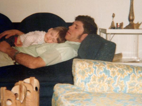 Courtney Farr sleeps on his father's chest when he was a young boy, in 1979.