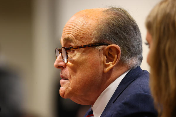 President Trump's personal attorney Rudy Giuliani speaks during an appearance last week before the Michigan House Oversight Committee in Lansing. Days later, it was revealed he had tested positive for the coronavirus.