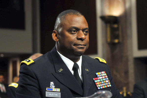 In this 2010 photo, Army Lt. Gen. Lloyd Austin appears at a Senate Armed Services Committee hearing on his  reappointment to be commander of the U.S. forces in Iraq. President-elect Joe Biden plans to nominate Austin as the first African-American to be defense secretary.