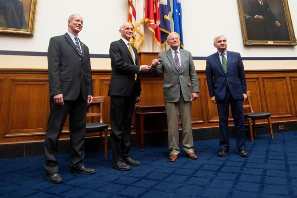 Leaders of the House and Senate Armed Services Committees Congressman Adam Smith (Center L), D-Wash., and Senator James Inhofe (C-R), R-Okla., participate in a ceremonial gavel passing while Senator Jack Reed (R), D-RI., and Congressman Mac Thornberry (L), R-Texas, look on at the US Capitol last month