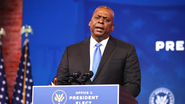 Retired Army Gen. Lloyd Austin speaks Wednesday in Wilmington, Del., after being formally introduced as President-elect Joe Biden's choice for secretary of the Department of Defense.