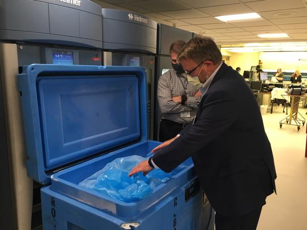 Tim Jennings (foreground) and Jon Horton, officials at Sentara Norfolk General Hospital in Norfolk, Va., have been lining up supplies, including dry ice, in preparation for the coronavirus vaccine.