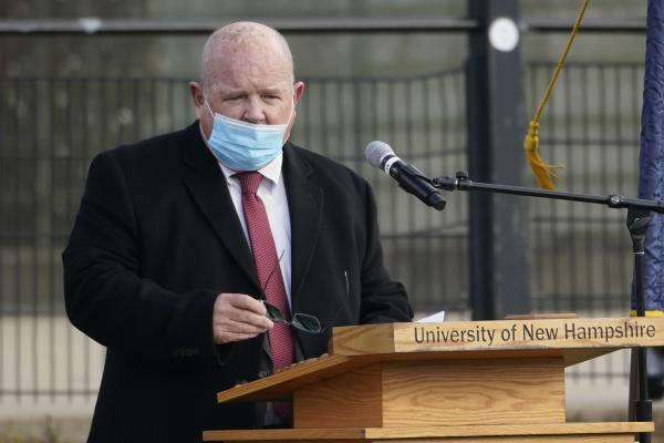 New Hampshire House Speaker Dick Hinch speaks on Dec. 2 during an outdoor legislative session at the University of New Hampshire in Durham, N.H. Hinch died of COVID-19 on Dec. 9, just a week after he was sworn in as leader of the state's newly Republican-led House. He was 71.