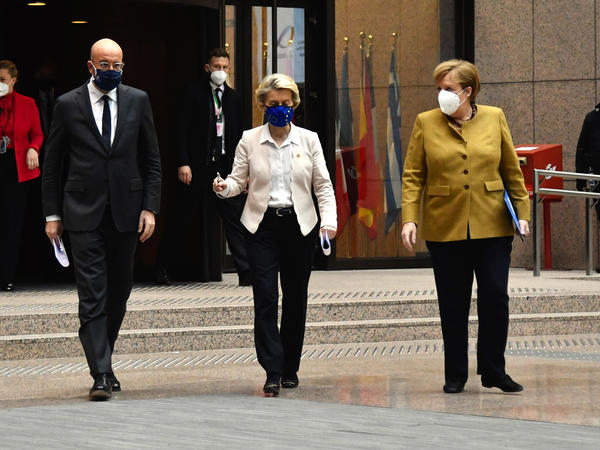 Charles Michel, president of the European Council (left); Ursula von der Leyen, president of the European Commission (center); and Angela Merkel, Germany's chancellor, wear protective face masks as they walk to a news conference at a European Union leaders summit Friday in Brussels.