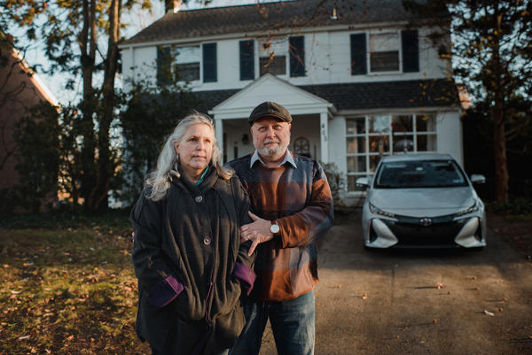 Debi and Nick Lemieur stand together at their home in Havertown, Pa.