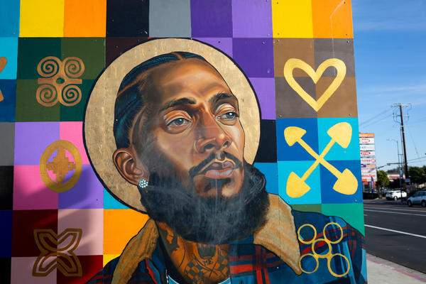 Nipsey Hussle is part of a mural painted by Moses Ball featuring other local notable people on the wall of a bank in the rapper's Hyde Park neighborhood. In the wake of Hussle's March 2019 death, many murals of the beloved Los Angeles musician were painted in the Hyde Park neighborhood near his Marathon Clothing store.