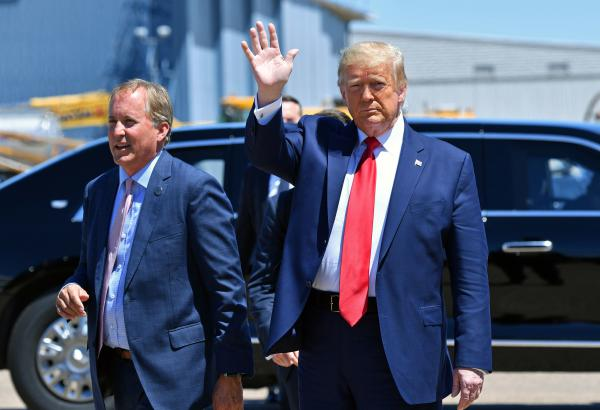 Texas Attorney General Ken Paxton, seen here with President Trump in June in Dallas, sued four states that Joe Biden carried in the general election, claiming their changes to election procedures during the pandemic violated federal law.