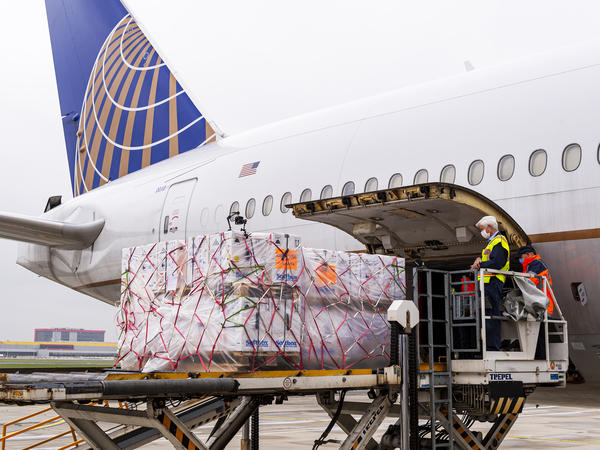 United is the first commercial airline to fly the first FDA-authorized COVID-19 vaccines to the U.S. Above, a cargo-only United flight carrying Pfizer's COVID-19 vaccine from Brussels to Chicago's O'Hare airport.