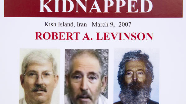 The Trump administration has sanctioned two Iranian officials over the disappearance and likely death of former FBI agent Robert Levinson, shown here in a March 6, 2012, FBI poster.