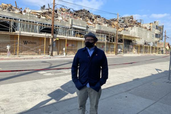 Manuel Bernal, president of East LA Community Corporation, stands in front of what remains of the Nuevo Amanecer complex, which had 30 units for homeless veterans.
