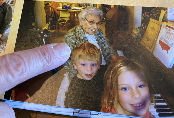 Phyllis McCosh sits at the piano with some of her great grandchildren. Music was a focal point for McCosh and her family.