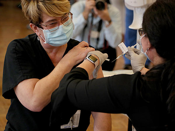 Respiratory care specialist Denise A. Beretta gets her COVID-19 vaccine Monday at Rhode Island Hospital in Providence, R.I.