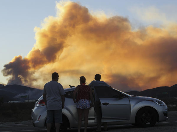 People watch the Blue Cut Fire in Lytle Creek, Calif., in 2016.