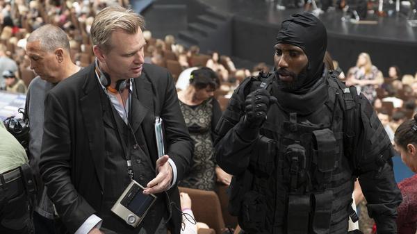 Director Christopher Nolan (left) and actor John David Washington on the set of <em>Tenet</em>.