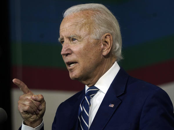 Joe Biden speaks about economic recovery during a campaign event at Colonial Early Education Program at the Colwyck Center in July. In an interview with Stephen Colbert, the president-elect defended his son Hunter, whose tax affairs are under investigation.