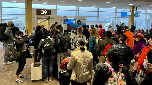 Crowds are seen at Washington's Reagan National Airport on Friday. More than a million people went through airport security each of the past two days, despite the coronavirus pandemic.