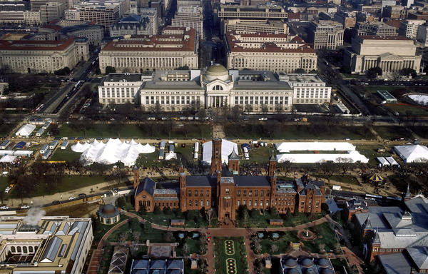 "An aerial view of the National Mall in Washington, D.C., with the Smithsonian Institution Building (""The Castle"") in the foreground and the Smithsonian's National Museum of Natural History in the background."
