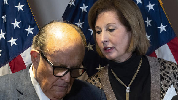 Rudy Giuliani, President Trump's personal attorney, with lawyer Sidney Powell last month in Washington. They, the Trump campaign and others face a lawsuit by an employee of Dominion Voting Systems, a vendor that has been the subject of disinformation from Trump and his allies.
