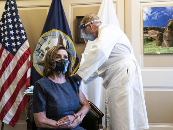 House Speaker Nancy Pelosi, D-Calif., receives a Pfizer-BioNTech COVID-19 vaccine shot from Brian Monahan, the attending physician for the U.S. Congress, last week.