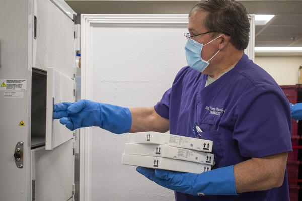 Hendrick Health Pharmacist Greg Perry puts doses of the Pfizer vaccine into an ultracold freezer. Hendrick Medical Center in Abilene has the ability to store the doses, but many rural facilities throughout the state do not.