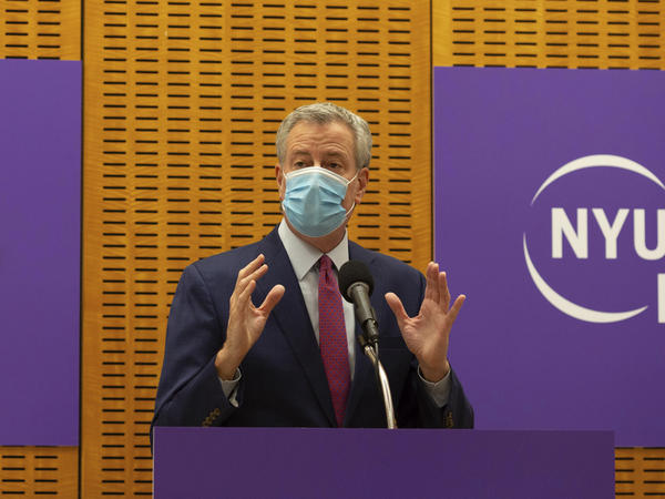 New York City Mayor Bill de Blasio announced that sheriff's deputies will be deployed to enforce quarantine protocols for travelers arriving from the United Kingdom. The mayor is seen above on Dec. 14. while delivering remarks ahead of the first COVID-19 vaccinations at NYU Langone Hospital.