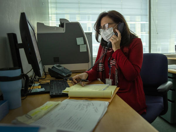 Contact tracer Toni Parlanti of Stamford, Conn., calls a person identified as having been potentially exposed to the coronavirus this week. States and territories report they have more than 70,000 people working on contact tracing as of December.