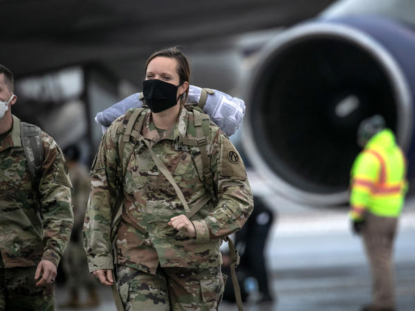 U.S. Army soldiers return from deployment to Afghanistan earlier this month at Fort Drum, N.Y.